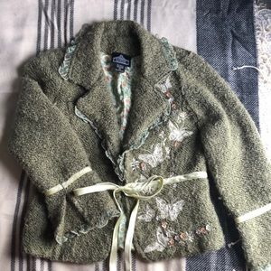 Moss green jacket with butterfly embellishment